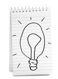 Bulb Sketch On Spiral Notebook Royalty Free Stock Photos