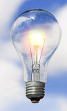 Bulb and sky. The bulb and cloudy sky Royalty Free Stock Image