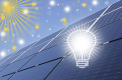 Bulb and solar energy panels. Renewable solar energy .Sustainable development of the environment Stock Images