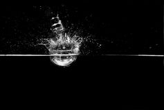 Bulb splash. Ing in water in a black and white photo Stock Photo