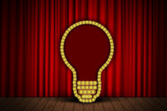 Bulb on stage curtain Royalty Free Stock Images