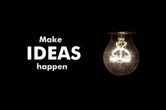 Bulb with text MAKE IDEAS HAPPEN Royalty Free Stock Images