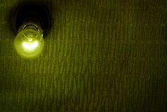 Bulb on wall Stock Photography