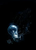 Bulb in water. With bubbles on black background Stock Photography