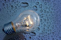 Bulb and water drops Stock Image