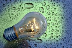 Bulb and water drops Royalty Free Stock Photo