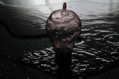 Bulb and wather. Picture of wather falling on the bulb with red filter Stock Photography