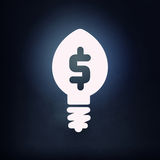 Bulb white icon. Light bulb icon with dollar sign on black background Royalty Free Stock Images