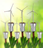 Bulb with wind turbine on plant Stock Photo