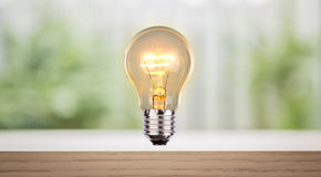 Bulb on wood shelf Royalty Free Stock Photo