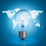 Bulb and world map. Light bulb on blue background world map Royalty Free Stock Photo