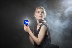 Bulb in your hand Royalty Free Stock Photography