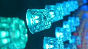 Bulbo cintilante do disco Fundo vívido abstrato em luzes de brilho, partículas efervescentes vídeos de arquivo