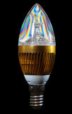 Bulbo de poupança de energia do diodo emissor de luz no fundo preto Fotografia de Stock