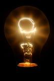 Bulbo del tungsteno con la flama foto de archivo libre de regalías