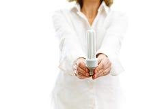 Bulbo fluorescente nas mãos Imagem de Stock Royalty Free