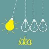 Bulbos colgantes de la luz ámbar. Movimiento perpetuo. Idea Fotos de archivo