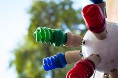 Bulbos de poupança de energia coloridos fotos de stock