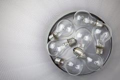 Bulbos eléctricos en el cubo de basura Imágenes de archivo libres de regalías