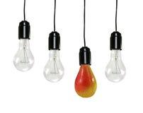 Bulbos eléctricos y una pera Fotografía de archivo libre de regalías