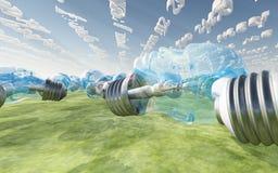 Bulbos hechos frente humanos y nubes lineares Foto de archivo libre de regalías