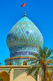 The dome of Ali Ibn Hamzeh Holy Shrine, Shiraz, Iran. The bulbous dome of medieval Ali Ibn Hamzeh Holy Shrine, decorated with tile geometric patterns in blue stock photos