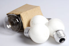 Bulbs. Electric lamps of the different setting on a light background Stock Photos