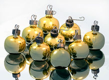 Bulbs. A computer-generated render illustration of gold holiday bulb ornaments on a reflective surface Stock Image