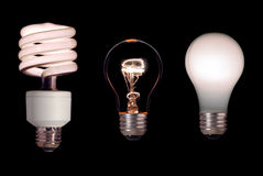 Bulbs. Three different light bulbs on a black background Royalty Free Stock Images