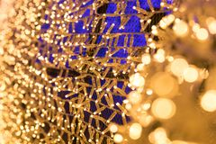 Bulbs glitter in tunnel lights and gold bokeh background. Bulbs glitter in tunnel lights and gold bokeh background, Blurred background Royalty Free Stock Photo