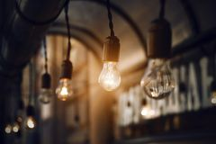 Bulbs glow brightly in the darkness of the night stock images
