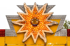 Bulbs light sun. Sunshine bulbs bumper carusel light sings royalty free stock photography