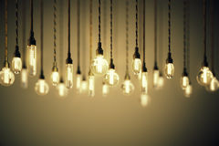 Bulbs with long filaments on brown background Royalty Free Stock Photos