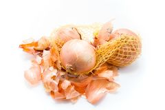 Bulbs and onion husks. On a white background Royalty Free Stock Photography