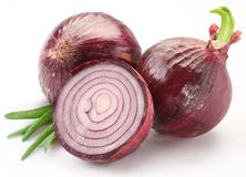 Bulbs of red onion with green leaves Royalty Free Stock Photography
