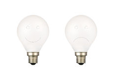 Bulbs with smiling face and sad face Stock Photos