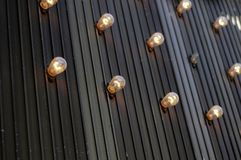 Bulbs on store facade Stock Images