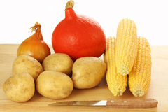 Bulbs of vegetables. On a plank next to the knife Stock Photo