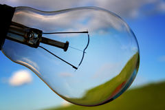 Bulbscape. A light bulb against a deep blue sky Royalty Free Stock Photos
