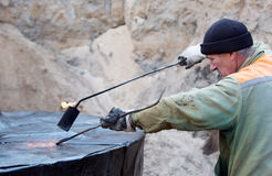 Bulder during waterproofing works with blowpipe torch Stock Images