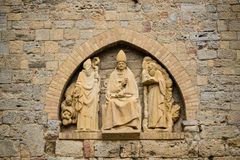 Bulding decoration with religious sculptures Stock Photos