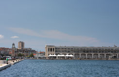 Bulding on Molo Bersagliery in Trieste, Italy on summer day. Royalty Free Stock Photography