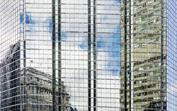 Bulding reflections on glass and steel side of a tower Royalty Free Stock Photography