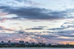Buldings below beautiful cloudy sky Royalty Free Stock Images