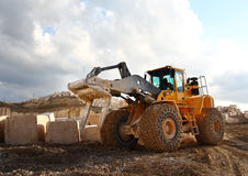 Buldozer in quarry. Buldozer with loader fork in marble quarry Royalty Free Stock Images