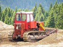 Buldozer at work. Medium bulldozer working in the mountains Stock Image