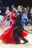 Buldyk Sergey y programa de Raiko Alena Performs Youth Standard European sobre la danza abierta Festival-2017 de WDSF Minsk foto de archivo