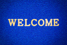 Bule doormat and welcome text. For background Royalty Free Stock Image
