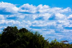 Bule sky mountain cloud. Home on royalty free stock photography