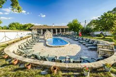 BULGAREVO, BULGARIA, AUGUST 09, 2016: cascade and swimming pool. In the eco complex bulgarevo surrounded by Lounge chairs Stock Photo
